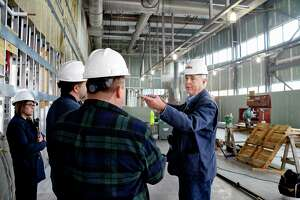 Dave Larkin, right, senior professor for manufacturing technology, leads a tour as construction continues for HVCC's new 37,000 square foot Gene Haas Center for Advanced Manufacturing Skills Thursday Nov. 8, 2018 in Troy, NY.  (John Carl D'Annibale/Times Union)