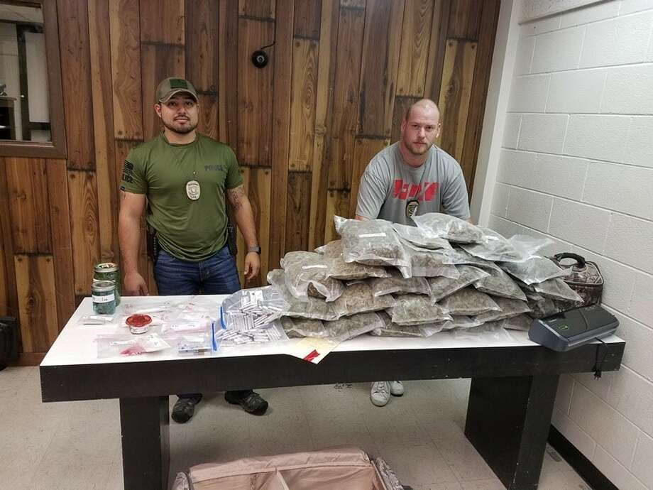 Detectives Jesse Ortiz and Curtis Bloom made a traffic stop that yielded 3,000 grams of THC product and 24 pounds of marijuana. Photo: Courtesy Photo/Plainview PD