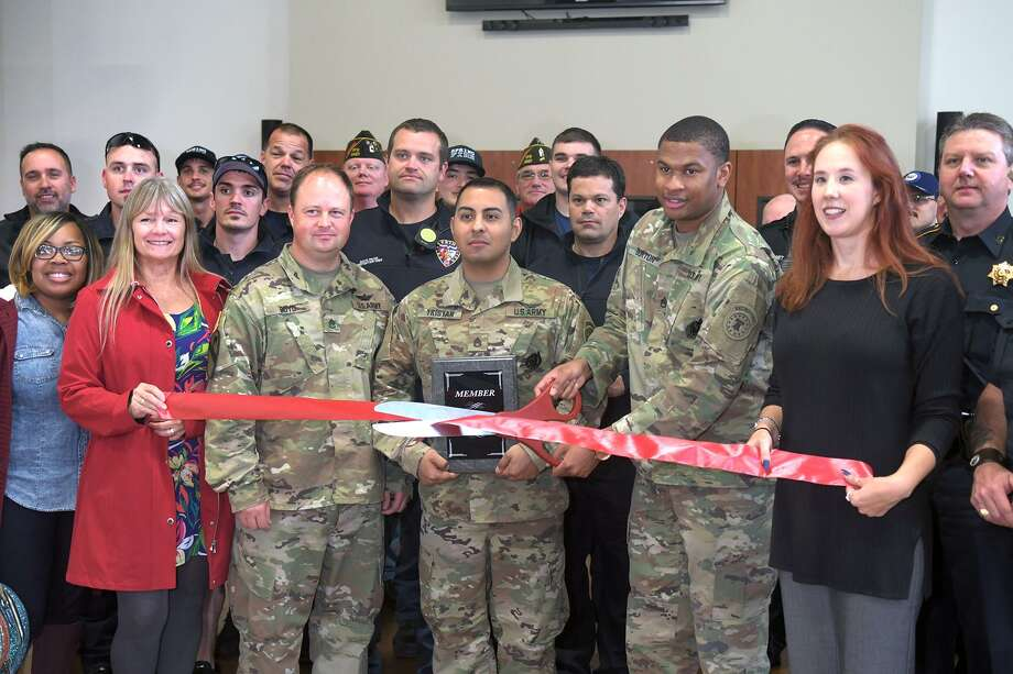Jenan Blank, from right, Executive Vice-President of Operations for the Spring Klein Chamber of Commerce, leads the ribbon cutting for the Klein Army Recruiting Station with US Army recruiters SSG Darrious Burton, SSG Joshua Tristan, and SSG Jeremy Boyd during the Spring Klein Chamber of Commerce 3rd Annual Military & 1st Responders Appreciation Luncheon at the Church at Creeks End in Spring on Nov. 9, 2018. Photo: Jerry Baker, Houston Chronicle / Contributor / Houston Chronicle