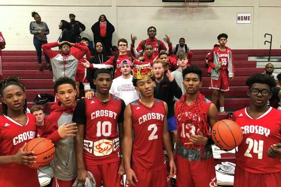 Crosby junior Caleb Bernardez (10) won the Cougar Rebound Belt, senior Shemar Johnson (2) was King of the Court, and senior Ashton Kenebrew was Knight of the Red net in the Cougars' 43-41 win over Lee on Jan. 30