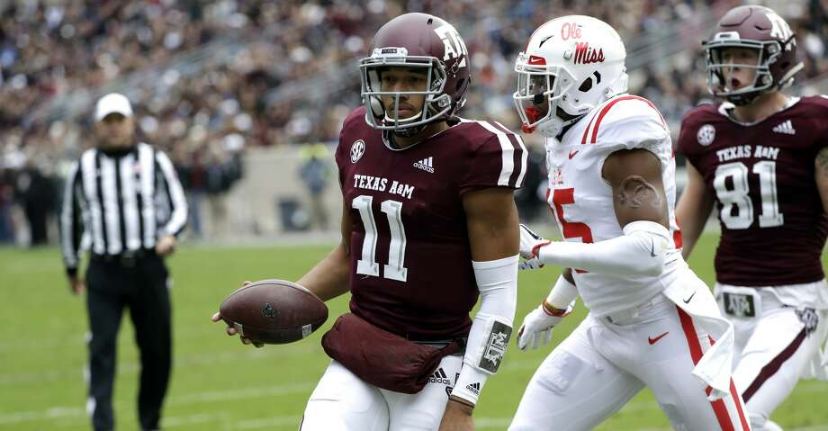 Texas A&M quarterback Kellen Mond (11) rushes for a touchdown as Mississippi Rebels defensive back Myles Hartsfield (15) defends during the first half of an NCAA college football game Saturday, Nov. 10, 2018, in College Station, Texas. (AP Photo/David J. Phillip) Photo: David J. Phillip/Associated Press