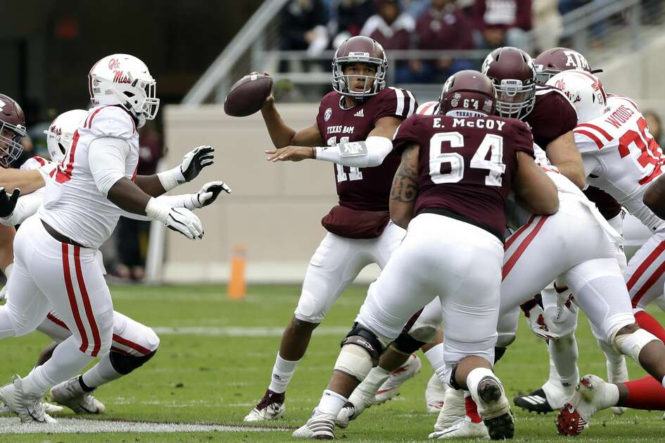 Texas A&M quarterback Kellen Mond (11) throws a pass against Mississippi during the first half of an NCAA college football game Saturday, Nov. 10, 2018, in College Station, Texas. (AP Photo/David J. Phillip)