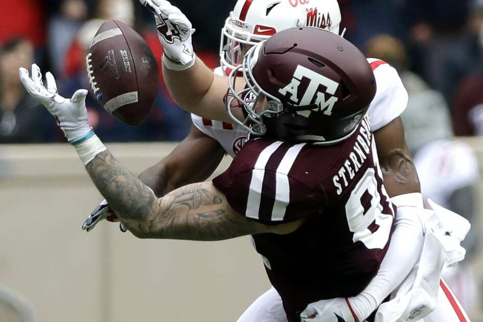 Texas A&M tight end Jace Sternberger (81) catches a pass for a first down as Mississippi Rebels defensive back Myles Hartsfield defends during the first half of an NCAA college football game Saturday, Nov. 10, 2018, in College Station, Texas. (AP Photo/David J. Phillip)