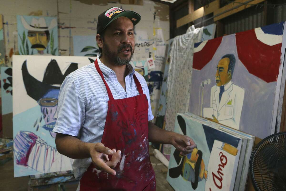 Local artist Cruz Ortiz speaks in his studio Monday September 19, 2016 about the art work he has created that will be used by Hillary Clinton's presidential campaign.
