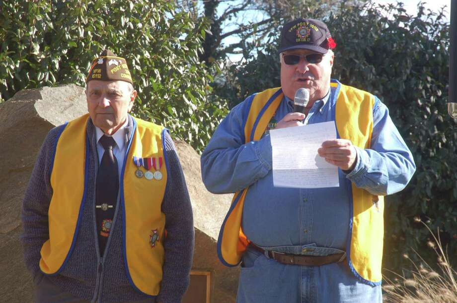At right, Cos Cob VFW Post 10112 Commander Joe Musich spoke Saturday at the post's annual Veterans Day ceremony. At left is post service officer Anthony Marzullo. Photo: Ken Borsuk / Hearst Connecticut Media