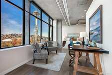 Two bedrooms and a multi-million dollar view for under a million in this Belltown loft/condo.