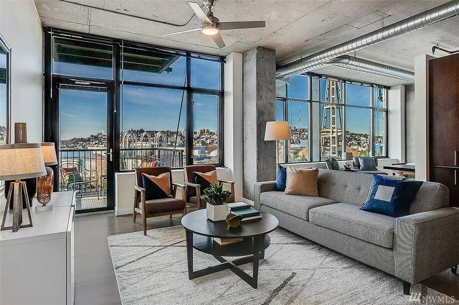 Two bedrooms and a multi-million dollar view for under a million in this Belltown loft/condo. Photo: Seattle Home Photography Via Windermere