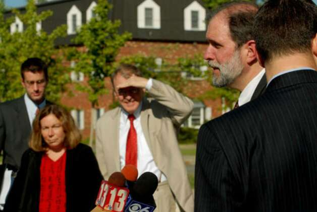 Michael P. McDermott, right, speaks with the media with defendant Christopher Porco and defense lawyers Laurie Shanks and Terence Kindlon in background Tuesday August 8, 2006. Photo: Michael P. Farrell