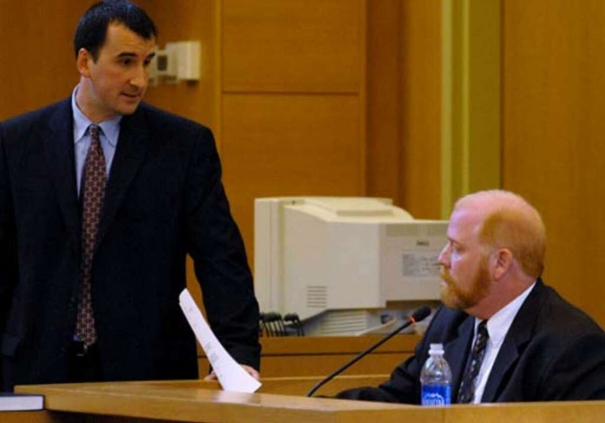Defense witness John Polster, right, is cross examined by assistant District Attorney David Rossi Tuesday, August 8, 2006.