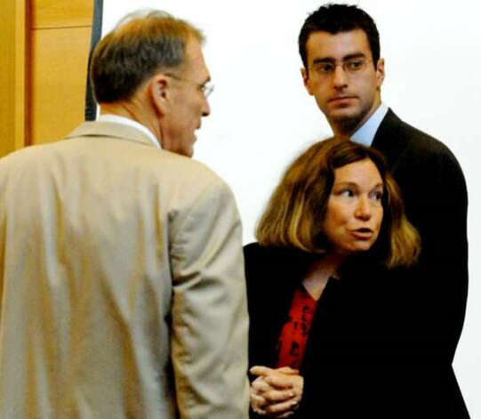 Christopher Porco with his defense attorneys Terence Kindlon, left, and Laurie Shanks in the Orange County Courthouse in Goshen Tuesday, August 8, 2006. Photo: Michael P. Farrell