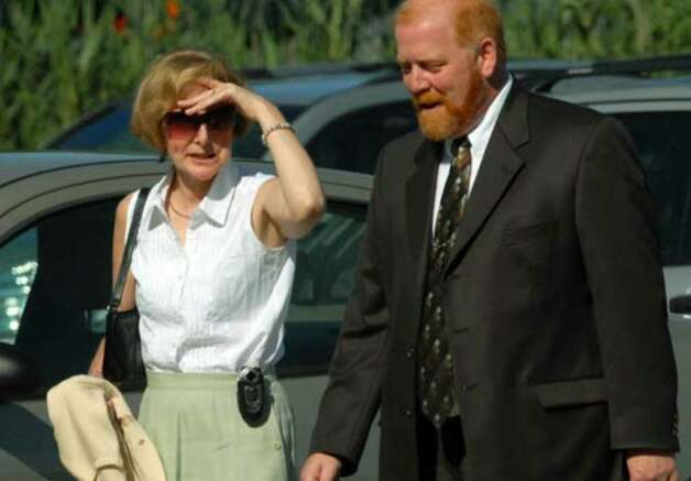 Joan Porco with close friend and attorney John Polster walk together into the Orange County Courthouse Tuesday August 8, 2006. Photo: Michael P. Farrell