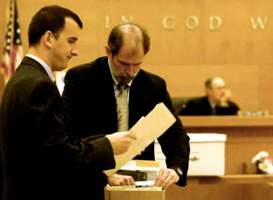 Albany County Chief Assistant District Attorney Michael McDermott, at right, and Assistant District Attorney David Rossi pack up evidence files as they prepare to rest the state's case against Christopher Porco on August 2, 2006. Photo: Michael P. Farrell
