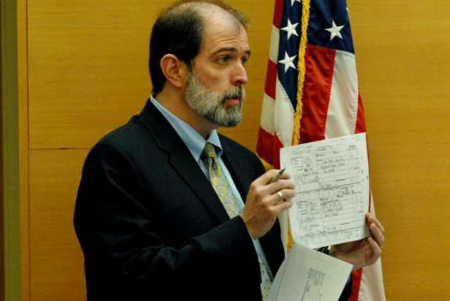 Albany County Chief Assistant District Attorney Michael P. McDermott holds up a copy of phone repair records as he questions witness Deborah LaCroix on August 2, 2006. Photo: Michael P. Farrell