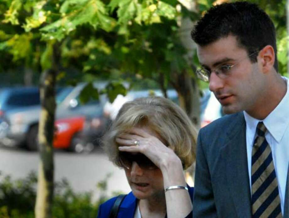 Joan Porco and her son Christopher Porco walk together into the Orange County Courthouse in Goshen, on the morning of August 2, 2006. Photo: Michael P. Farrell