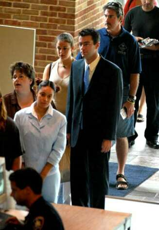 Christopher Porco with a female friend, wait in line Thursday to pass through security at the Orange County Courthouse in Goshen. Photo: Michael P. Farrell