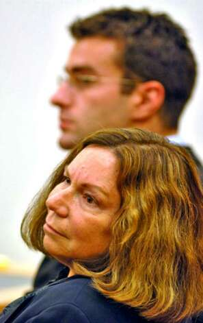 Defense lawyer Laurie Shanks listens to the prosecution while sitting with defendant Christopher Porco on Monday. Photo: Philip Kamrass