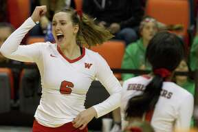 The Woodlands outside hitter Courtney Heiser (6) celebrates a point during the third set of a Region II semifinal match at Johnson Coliseum, Friday, Nov. 9, 2018, in Huntsville.