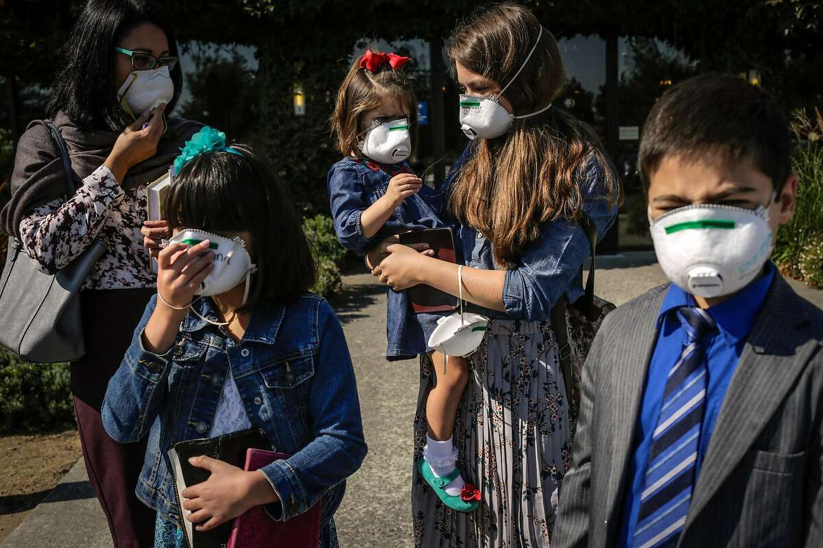 (l-r) Family members Melody Scott, Jenna Scott, 9, Olivia Scott, 3, Kaylee Scott, 12, and Daniel Scott, 9 stand outside the Doubletree Hotel after attending services with their church the New Hope Baptist Church in Rohnert Park, Calif., on Sunday, Oct. 15, 2017. The services were being held at the Doubletree because the church was in an evacuation zone due to the fires in the area. Many people were grieving the loss of homes and lives due to the destruction caused by several fires in the area.