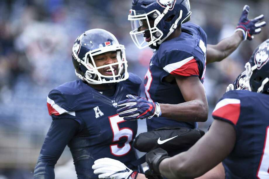UConn quarterback David Pindell celebrates with wide receiver Keyion Dixon after Pindell scored in the first half against SMU on Saturday. Photo: Stephen Dunn / Associated Press / Copyright 2018 The Associated Press. All rights reserved