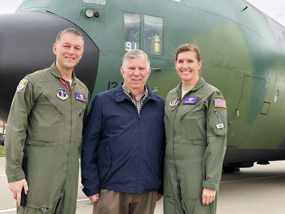 U.S. Air Force Lt. Col. Howard W. Dixon, center, poses with Commander Col. Byron Newell and Vice Commander Col. Deanna Franks at a recent Advanced Airlift Tactics Technical Center reunion. Photo: Contributed Photo / Contributed Photo / Norwalk Hour contributed