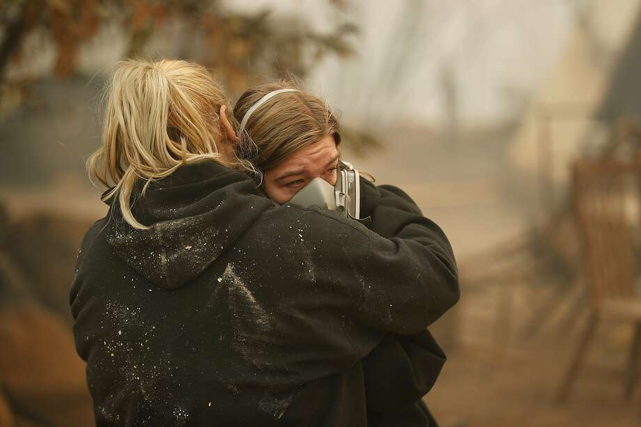 Krystin Harvey, left, comforts her daughter Araya Cipollini at the remains of their home burned in the Camp Fire, Saturday, Nov. 10, 2018, in Paradise, Calif.  Photo: John Locher / Associated Press