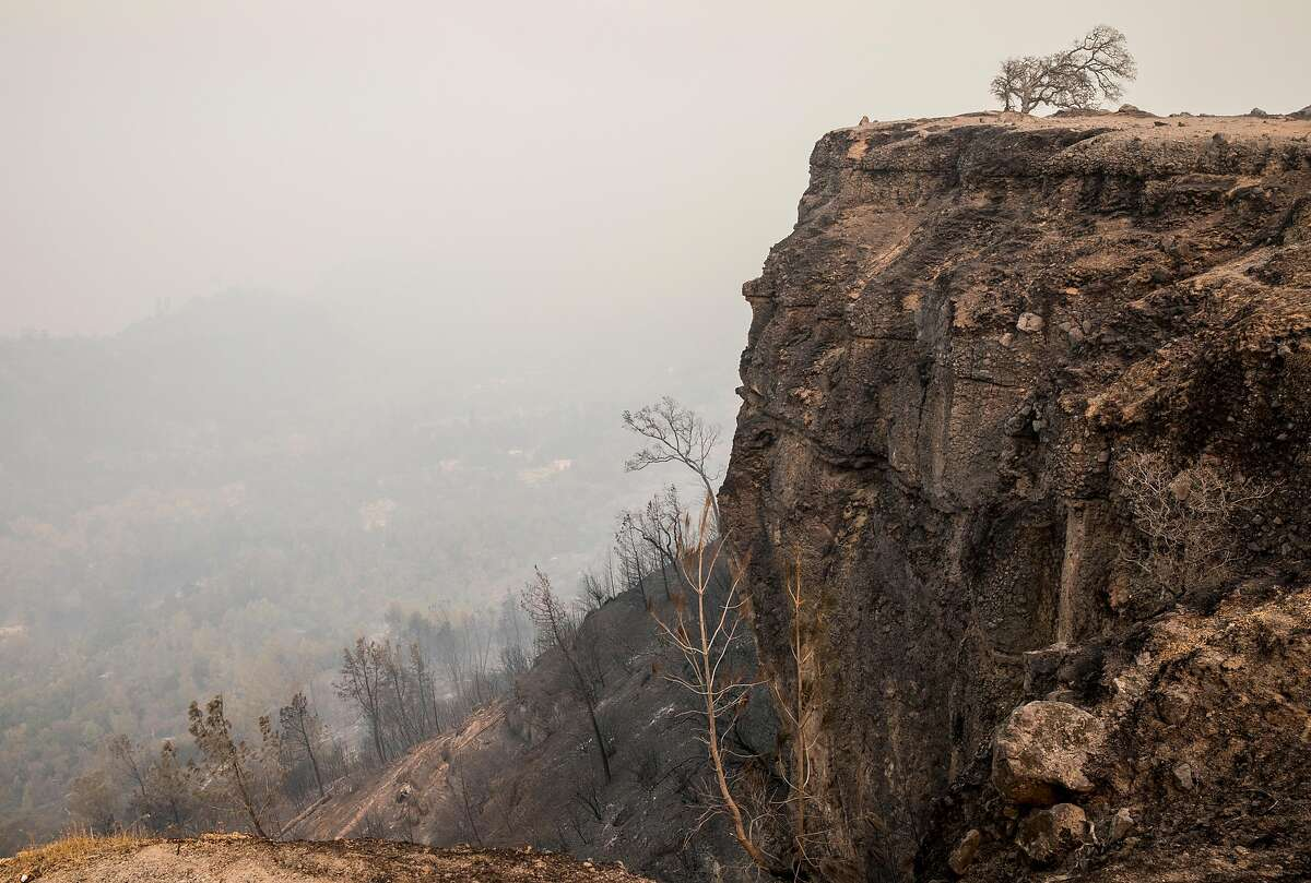 Smoke fills the canyon above Butte Creek as the Camp Fire rips through the town of Paradise, Calif. and beyond Saturday, Nov. 10, 2018.