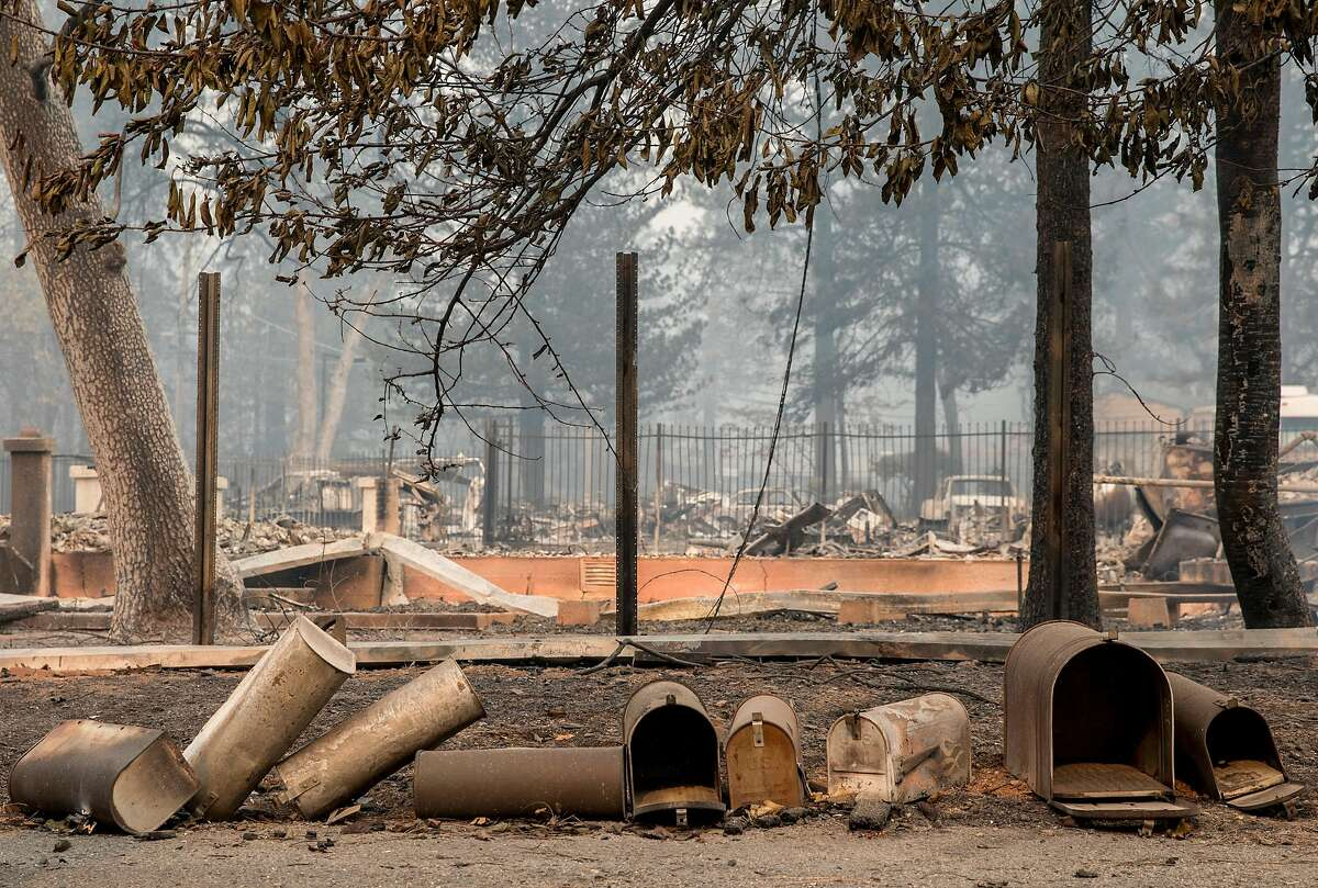 Charred mailboxes sit on the ground along Lisa Lane after the Camp Fire devastated the entire town of Paradise, Calif. Saturday, Nov. 10, 2018.