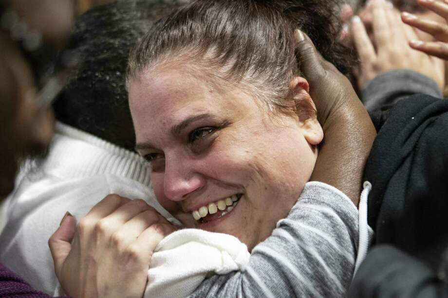 Conroe resident Dafni Vrionis and Houston resident Trudie Cole hug after both women received cars at God's Garage on Saturday, Nov. 10, 2018 in Conroe. God's Garage gave away nine vehicles to women in need. Photo: Cody Bahn, Houston Chronicle / Staff Photographer / © 2018 Houston Chronicle