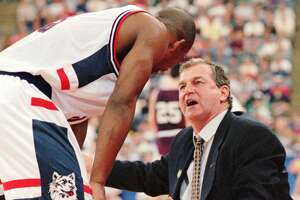 UConn coach Jim Calhoun talks to Rashamel Jones on the sidelines during the first half of the Huskies' 68-59 win over Colgate on March 14, 1996 in Indianapolis in the NCAA Southeast Regional.