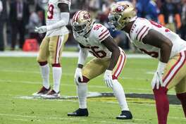 San Francisco 49ers' Reuben Foster (56) plays his linebacker position against the Arizona Cardinals offense during the first half of an NFL football game, Sunday, Oct. 28, 2018, in Glendale, Ariz. (AP Photo/Darryl Webb)