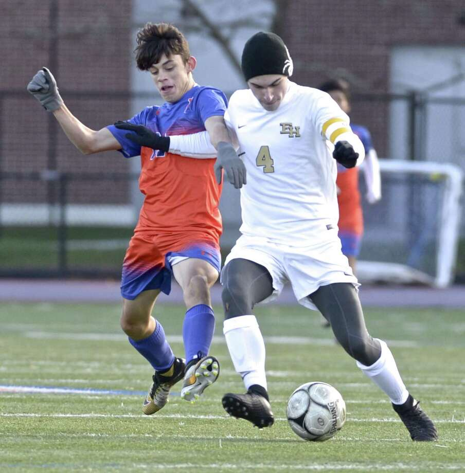 Danbury's Lucas Oliveira (21) and East Hartford's Dante Talamini (4) fight for the ball in the boys Class LL quarter finals soccer game between East Hartford and Danbury high schools, Saturday afternoon, November 10, 2018, at Danbury High School, in Danbury, Conn. Photo: H John Voorhees III / Hearst Connecticut Media / The News-Times