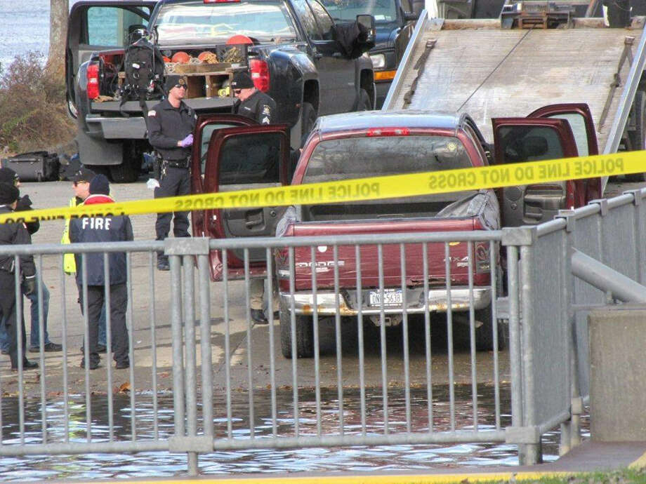 A pickup truck belonging to an East Greenbush man missing since Monday was pulled from the Hudson River in Schodack Landing on Saturday morning. The man, David Burden, remains missing, police said. Photo: Martin Miller, Special To The Times Union