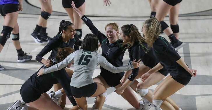 Kingwood Park #1 Katey Searcy  (center) leads her team celebrating after defeating Friendswood in the final of the UIL Girls Regional III 5A Volleyball Championship Tournament  Saturday, Nov. 10, 2018, in Houston.