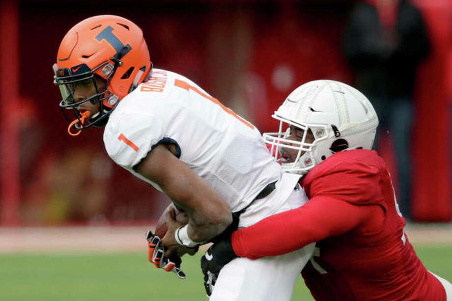 Nebraska's Khalil Davis (right) sacks Illinois quarterback AJ Bush Jr. during Saturday's Big Ten game in in Lincoln, Neb. Photo: Associated Press