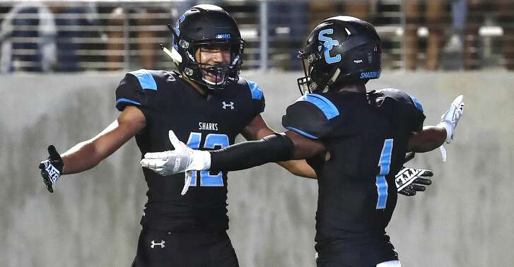 Shadow Creek High's wide receiver Kealon Jackson (1) celebrates his touchdown with Axel Cruz (12) during the second half of a high school football game at Freedom Field, Friday, September 28, 2018, in Iowa Colony.