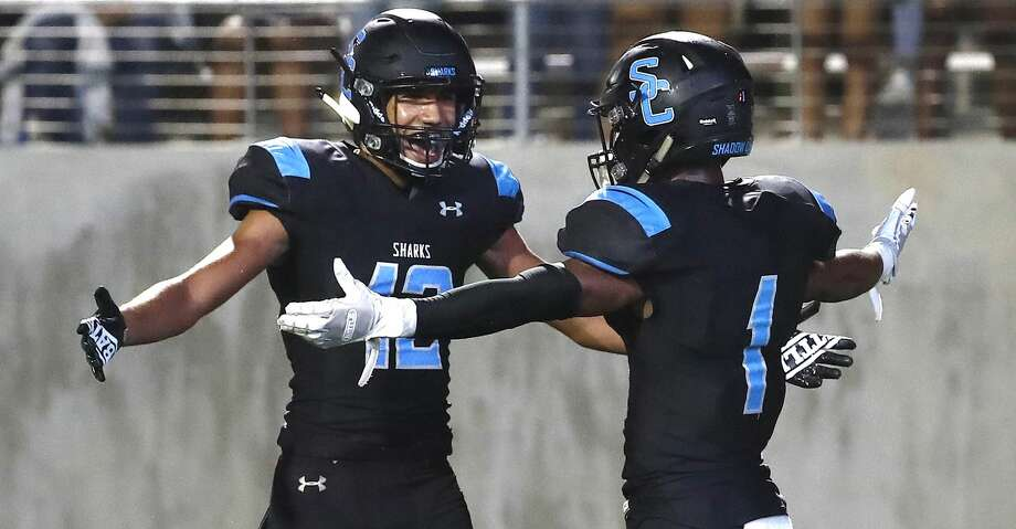 Shadow Creek High's wide receiver Kealon Jackson (1) celebrates his touchdown with Axel Cruz (12) during the second half of a high school football game at Freedom Field, Friday, September 28, 2018, in Iowa Colony. Photo: Karen Warren/Staff Photographer