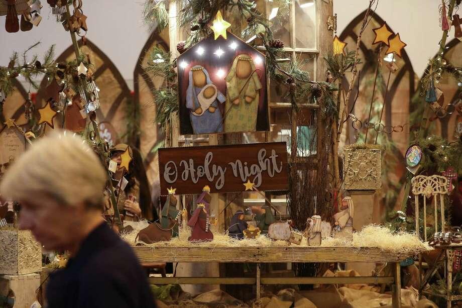 A shopper passes a nativity scene during the 38th annual Houston Ballet Nutcracker Market Cruising into Christmas in the NRG Center Saturday, Nov. 10, 2018, in Houston. Photo: Steve Gonzales, Houston Chronicle / Staff Photographer / © 2018 Houston Chronicle