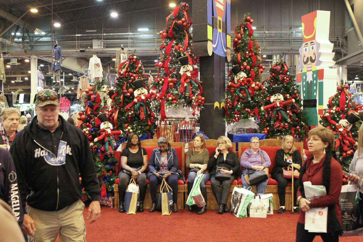 Shoppers find a place to rest during the 38th annual Houston Ballet Nutcracker Market Cruising into Christmas in the NRG Center Saturday, Nov. 10, 2018, in Houston.