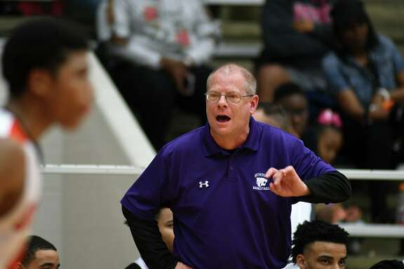 Humble head coach Lair Crawford pumps up his team against Texas City in their Region III-5A Area Playoff matchup at Phillips Fieldhouse in Pasadena on Feb. 23, 2018.