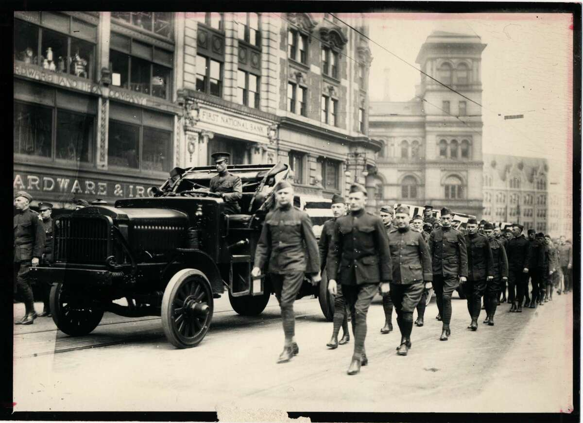 Local World War I veterans march on State Street and Broadway in 1918.