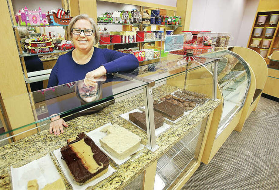 Rebecca Pattan, owner of Poputopia, stands at the confection counter in the business Friday. The shop is doing well in its new location inside Alton Square Mall, where it has been since its move from its former East Delmar location earlier this month. Photo: John Badman | The Telegraph