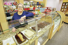 Rebecca Pattan, owner of Poputopia, stands at the confection counter in the business Friday. The shop is doing well in its new location inside Alton Square Mall, where it has been since its move from its former East Delmar location earlier this month.