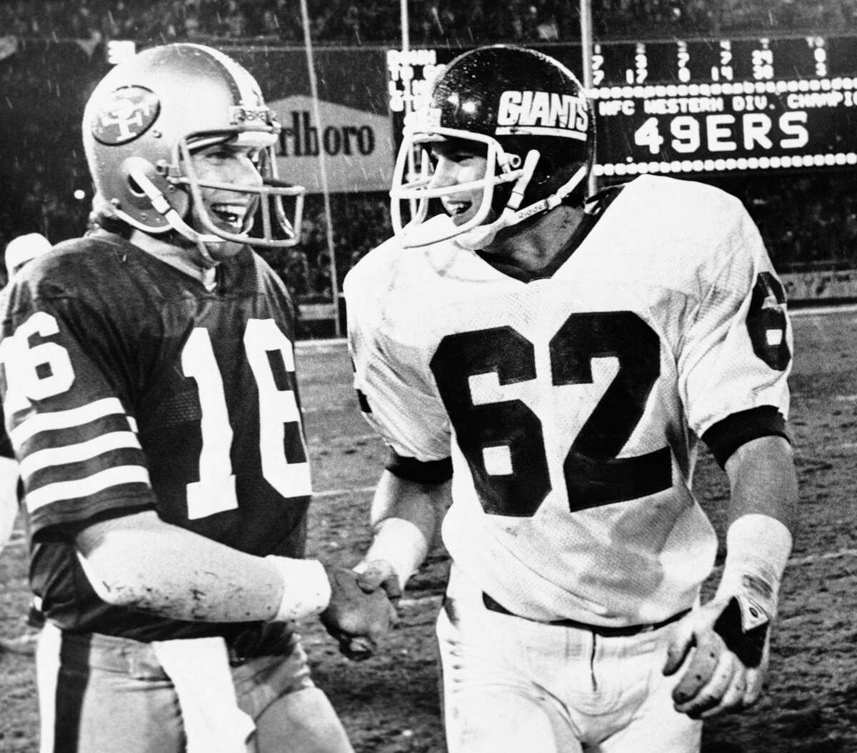 San Francisco Forty Niners quarterback Joe Montana (16) gets a handshake from New York Giants Mike Whittington (62) after a 38-24 win over the New Yorkers in the NFC Playoffs at Candlestick Park, Sunday, Jan. 3, 1982, San Francisco, Calif. (AP Photo)