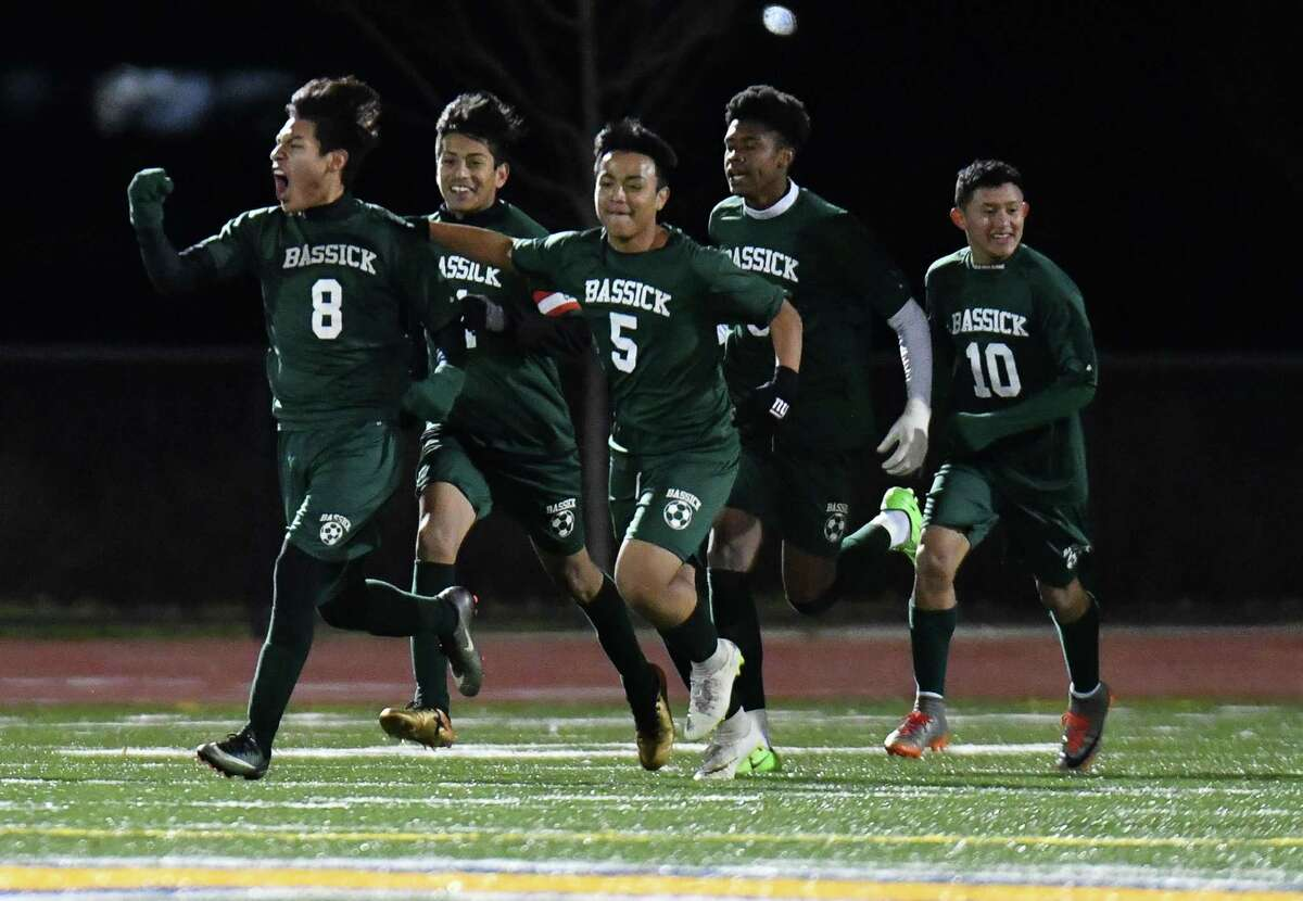 Kevin Sampayo Mones (8) and the Bassick Lions celebrate his goal during a CIAC Class L quarterfinal game against the Avon Falcons on Saturday November 10, 2018 at Harding High School in Bridgeport, Connecticut.
