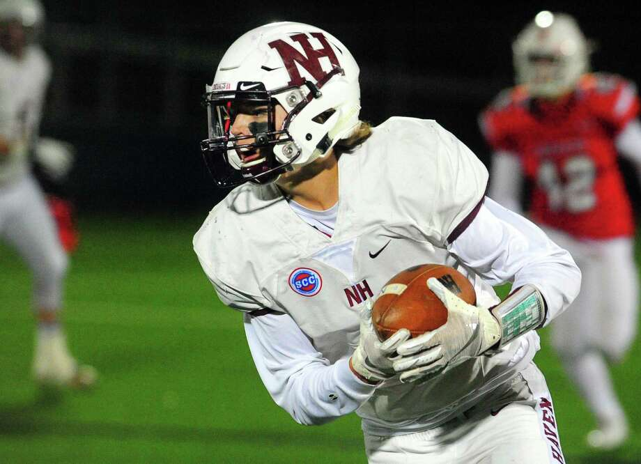 North Haven's Noah Perillie (4) carries the ball during football action against Fairfield Prep in Fairfield, Conn., on Saturday Nov. 10, 2018. Photo: Christian Abraham / Hearst Connecticut Media / Connecticut Post