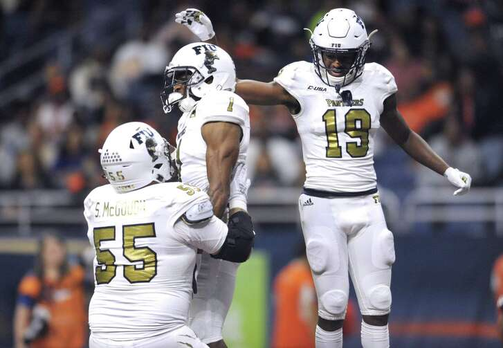 Florida International wide receiver Maurice Alexander (1) celebrates with teammates Shane McGough (55) and Shemar Thornton (19) after catching a first-half touchdown pass during college football action against UTSA in the San Antonio Alamodome on Saturday, Nov. 10, 2018.