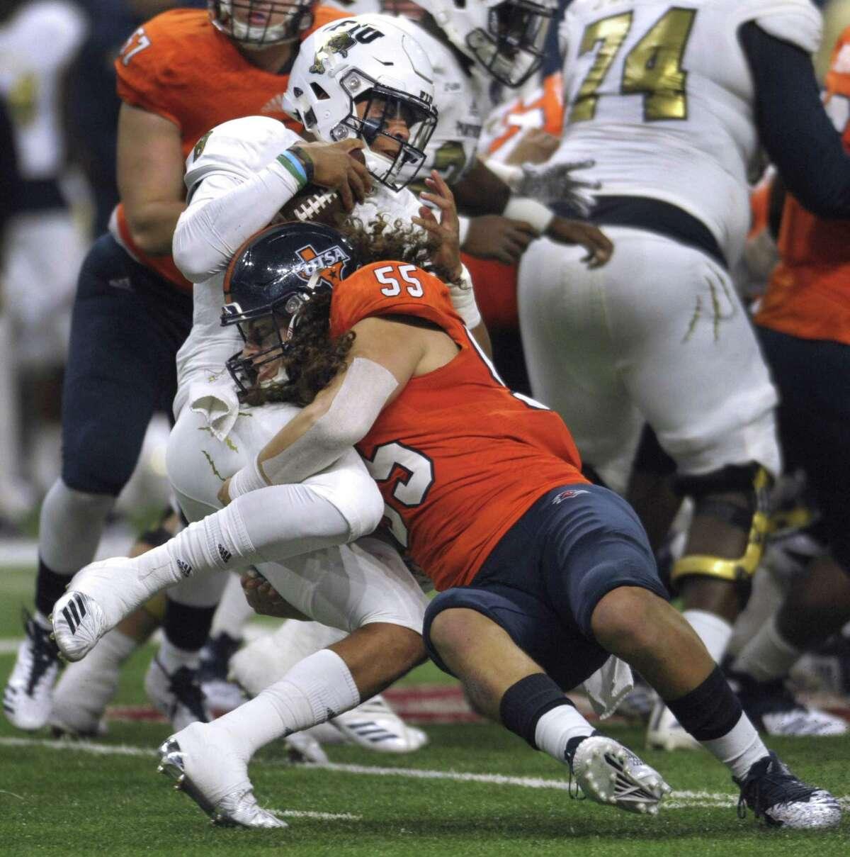 UTSA linebacker Josiah Tauaefa tackles FIU quarterback Christian Alexander during second-half college football action in the San Antonio Alamodome on Saturday, Nov. 10, 2018.