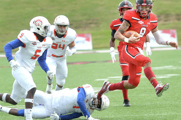 Lamar's Jordan Hoy slips away from Houston Baptist's Raphael Lewis during the Cardinals' final home game of the season Saturday. Photo taken Saturday, November 10, 2018 Kim Brent/The Enterprise