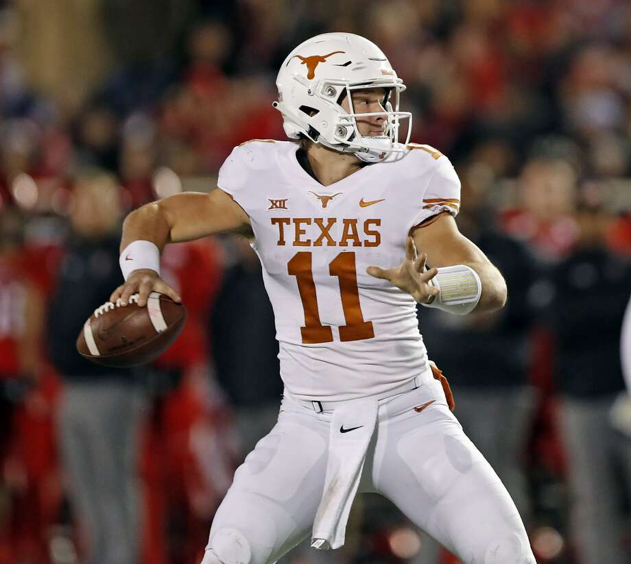 Texas' Sam Ehlinger (11) looks to pass the ball during the first half of an NCAA college football game against Texas Tech, Saturday, Nov. 10, 2018, in Lubbock, Texas. (AP Photo/Brad Tollefson) Photo: Brad Tollefson, Associated Press