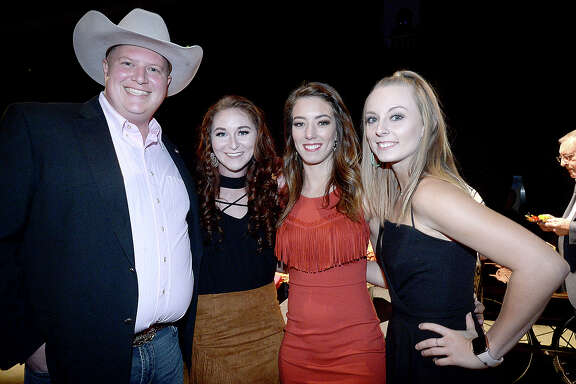 Kevin Norton, Breanna Whitten, Kate Weber and Summer Jackson were at the annual Southeast Texas Cattle Baron's Ball, held Saturday night at the Beaumont Civic Center. The theme of this year's event was Urban Cowboy and featured a star performance by Mickey Gilley and Johnny Lee. Proceeds from the event, which includes Texas dining, games, and silent auctions, benefit the American Cancer Society. Photo taken Saturday, November 10, 2018 Kim Brent/The Enterprise